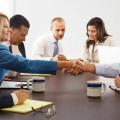 Handshake in a Business Meeting --- Image by © Tim Pannell/Corbis